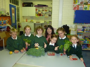 The Green Team with locally grown fruit and vegetables.